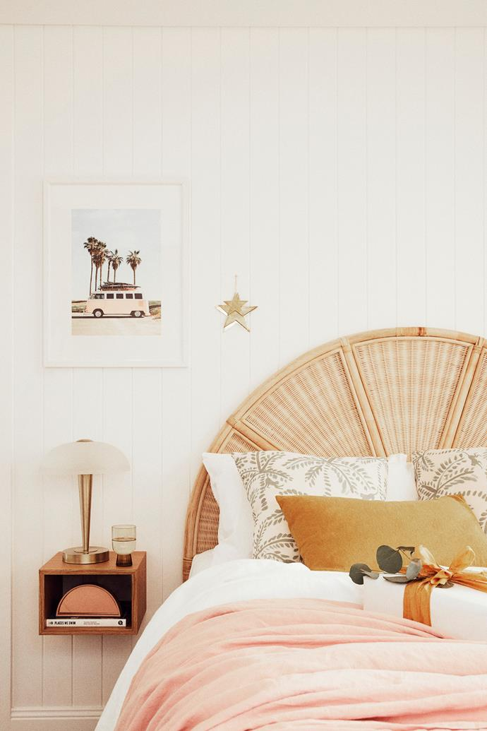 A rattan bedhead from GlobeWest continues the retro beach vibes, as do the Society6 framed print and Fat Shack Vintage lamp. A pink bedspread from I Love Linen and palm-print cushions from These Walls provide a glimpse of Claire's maximialist tendencies. The stars on the wall are Tigmi Trading.