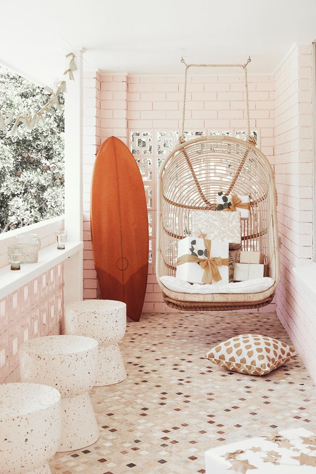 "This cosy nook on the balcony of [Claire Alexander-Johnston's Brunswick Heads home](https://www.homestolove.com.au/jetset-mama-house-brunswick-heads-20962|target=""_blank"") is her favourite spot. ""I love the tiles with the terrazzo Fenton&Fenton stools, the hanging chair from Byron Bay Hanging Chairs and most importantly, the people watching."""