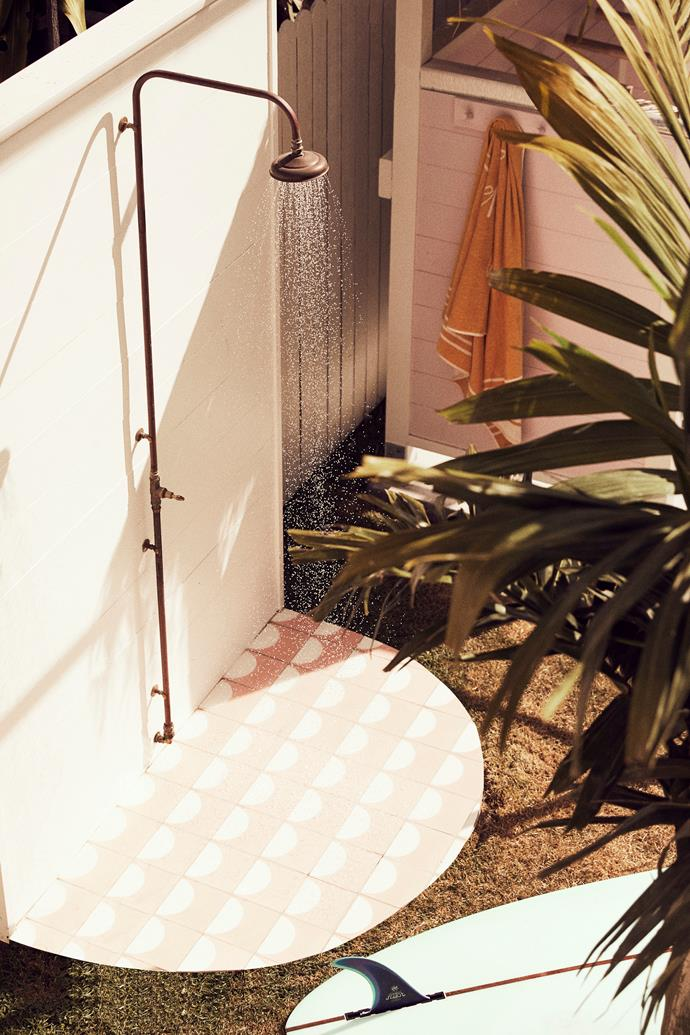 Passing shower Tiles by Sarah Ellison form the base of the outdoor shower. Yellow towel by The Beach People.