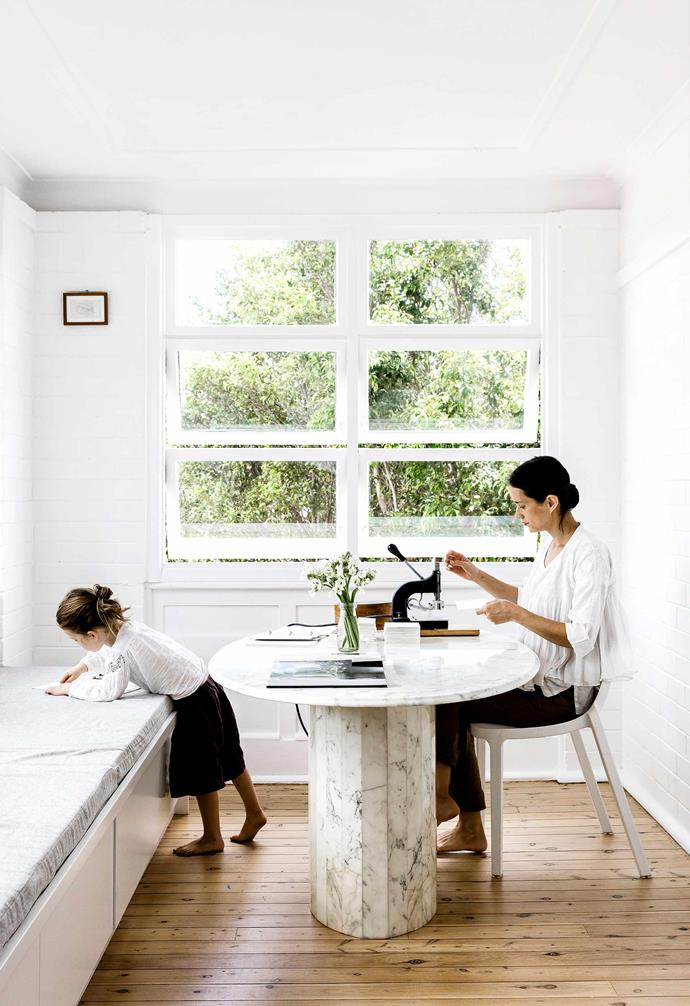 """**Sunroom** Homeowner Jessie uses an antique letter press while seated at a marble table sourced on [Gumtree](https://www.gumtree.com.au/