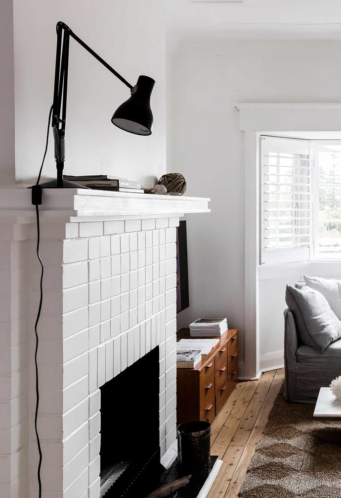 """**Living area** An Anglepoise Type 75 desk lamp peers over the original fireplace — Jessie and husband Russell repainted it and installed an [EcoSmart Fire](https://ecosmartfire.com.au/