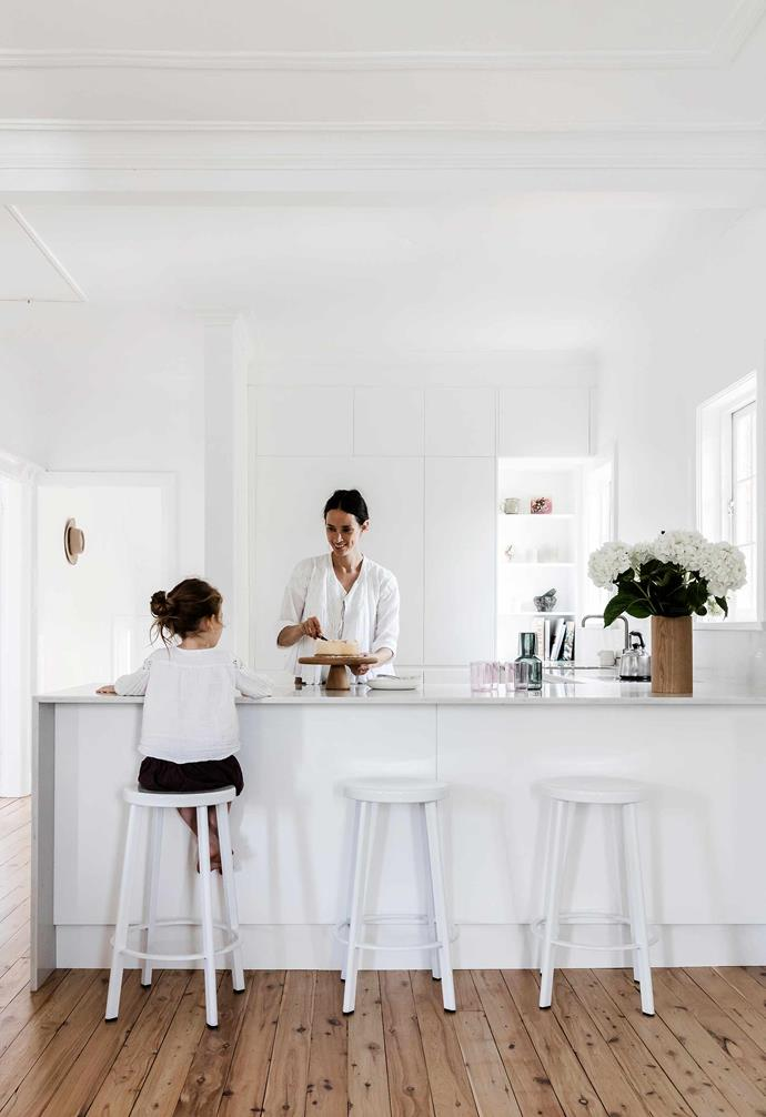 """**Kitchen** Clean, clinical joinery prevents clutter and hides an integrated fridge. A [Smartstone](https://www.smartstone.com.au/