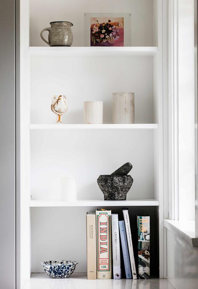 """**Kitchen** This corner is home to """"mostly personal items from my parents' house, and the mortar and pestle is from my grandmother's kitchen in Malaysia"""", says Jessie."""