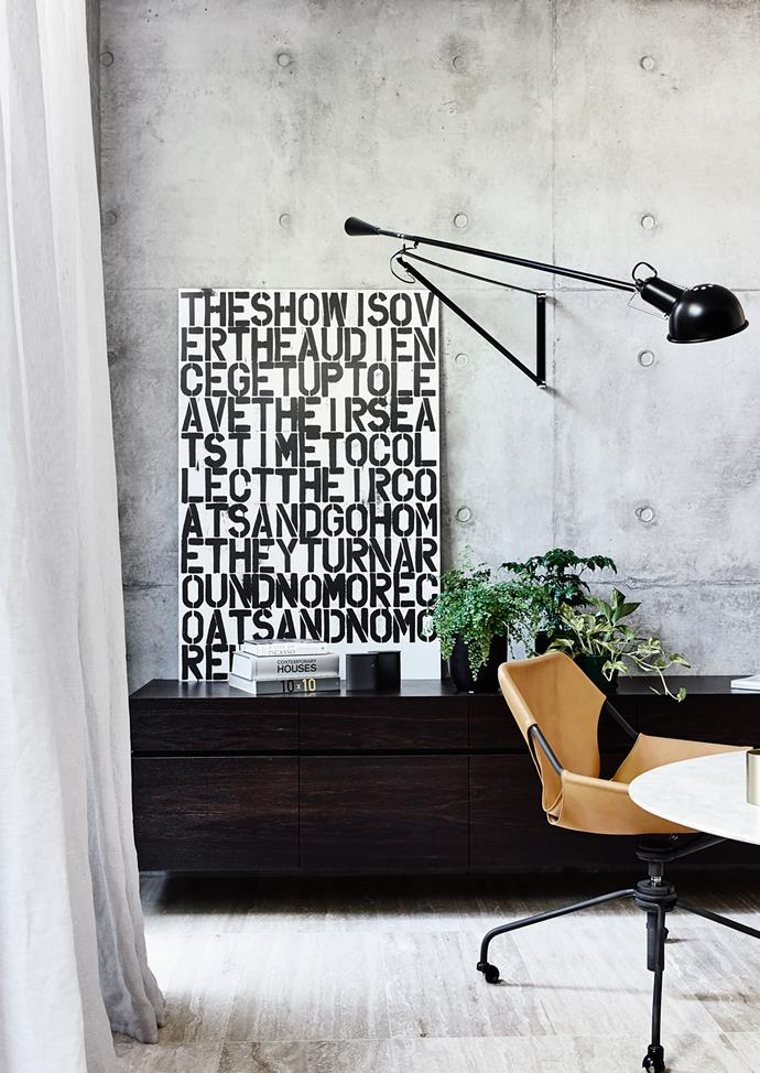 Paulistano 'Task' chair from Hub and Saarinen marble table in the study. Camerich 'Max' credenza from Meïzai. Typographical artwork is Untitled by Christopher Wool.