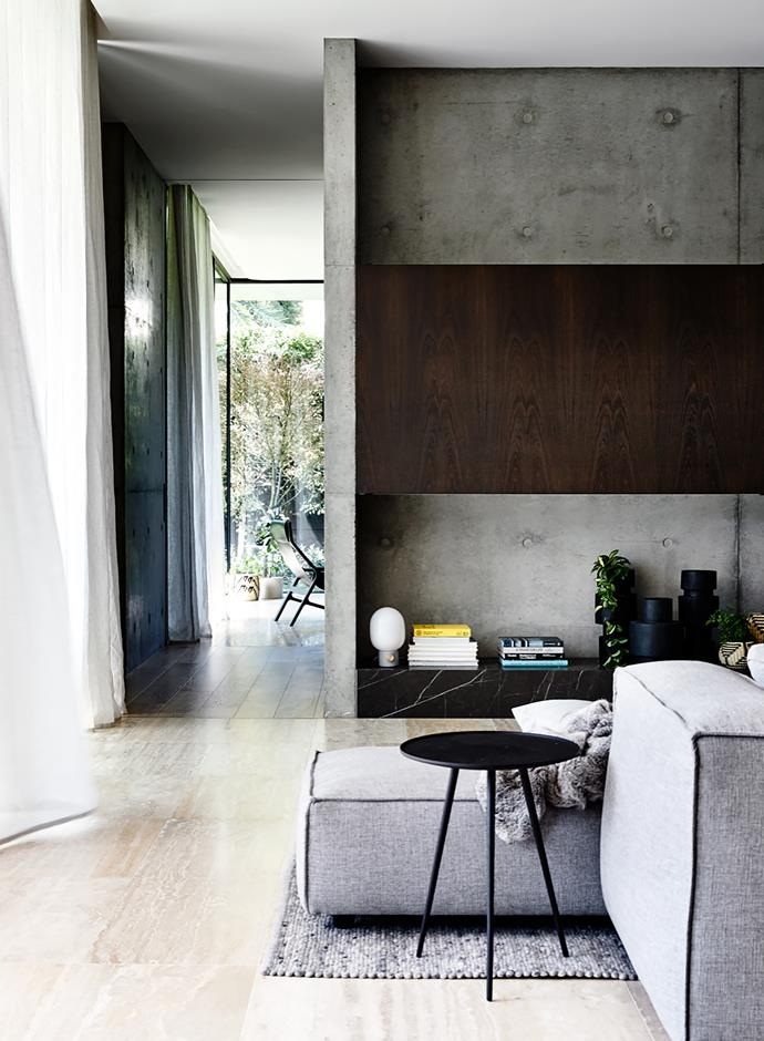Timber and concrete backdrop enlivened with Pietra Grigio marble. Living Divani sofa. Ligne Roset occasional table from Domo. Lamp from Norsu Interiors.