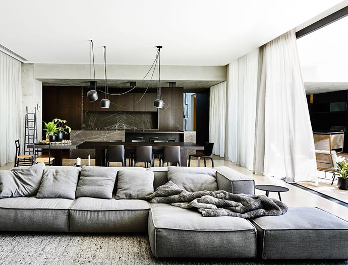 Living Divani sofa. Ligne Roset 'Linden' occasional table from Hub. Poliform 'Manta' chairs surround a custom table with stone extension by Zuster. Flos 'Aim' lightfitting. Ligne Roset ladder. Gubi 'Branca' kitchen stools. 'Fifty' outdoor chair from Domo.