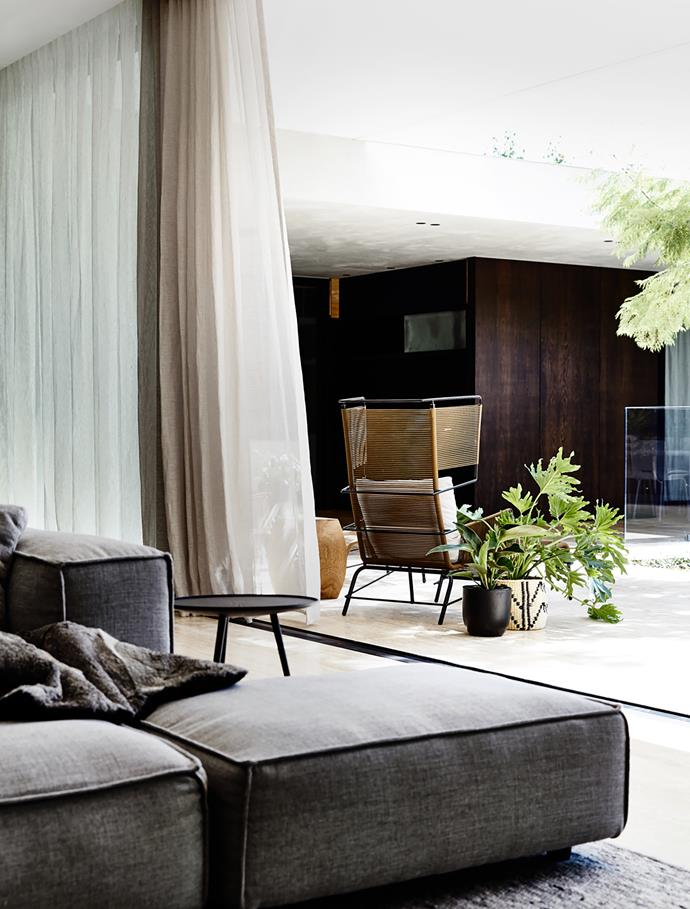 Fifty' chair from Domo offers a spot to relax. Living Divani sofa. Ligne Roset occasional table from Domo.
