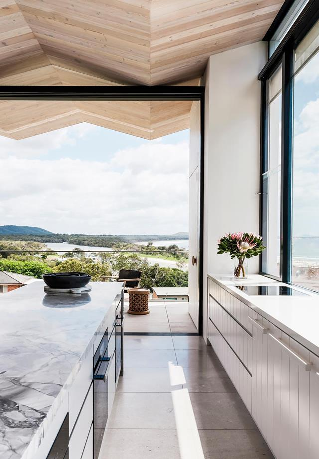 With a ceiling that traces the peaks of nearby surf and mountains, this home slots right in to its laidback surrounds. Photo: Robert Walsh