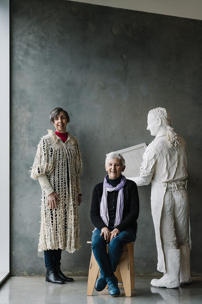 Pam (seated) with daughter Lyndal and one of Pam's life-size paper sculptures.