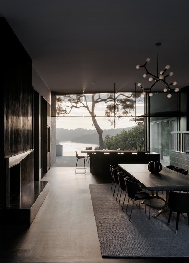 Looking through the dining area across the kitchen bench to the view of Sydney's Middle Harbour. Photo: Felix Forest | Words: Judy Pascoe