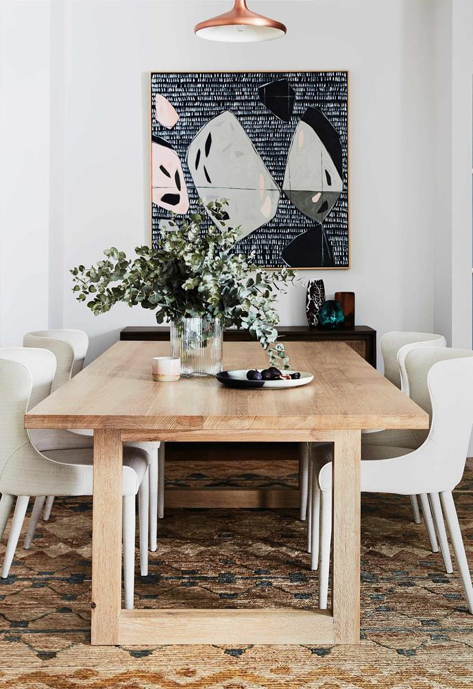 """**Dining area**  Leah is a fan of good-quality furniture that's made to last, hence her choice of the Luxa dining table (from [Totem Road](https://www.totemroad.com/ target=""""_blank"""" rel=""""nofollow"""")) and Markson dining chairs in Ivory (from [Coco Republic](https://www.cocorepublic.com.au/ target=""""_blank"""" rel=""""nofollow"""")). Artwork by [Carly Williams](https://www.instagram.com/carlywilliamsart/?hl=en target=""""_blank"""" rel=""""nofollow"""")."""