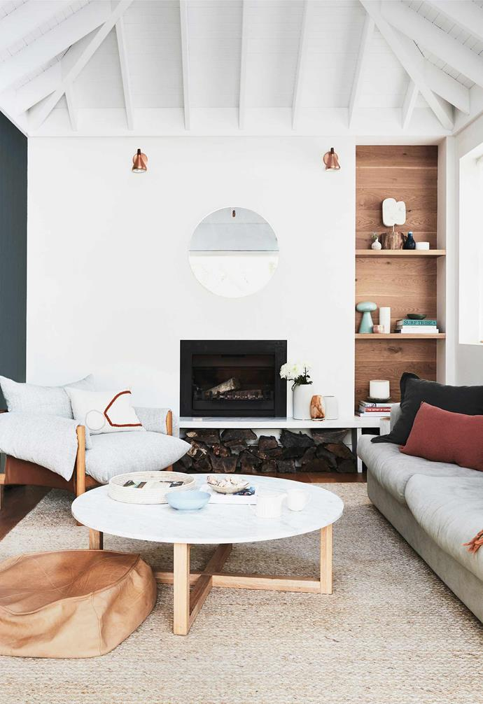 """**Living room** Not unlike the rock formations at Clovelly Beach, the scene in the [Aquabumps](https://www.aquabumps.com/ target=""""_blank"""" rel=""""nofollow"""") photograph above the sofa is called *Mediterranean Melt*. """"I haven't been to the Amalfi Coast yet,"""" says Leah, """"but I can definitely imagine basking in that beautiful water one day."""" The Long Beach sofa is from [Coco Republic](https://www.cocorepublic.com.au/ target=""""_blank"""" rel=""""nofollow""""). Wilfred armchair, ottoman and throw, [Jardan](https://www.jardan.com.au/ target=""""_blank"""" rel=""""nofollow""""). Kara marble coffee table, [Totem Road](https://www.totemroad.com/ target=""""_blank"""" rel=""""nofollow""""). Hang 1 mirror, [Blu Dot](https://www.bludot.com.au/ target=""""_blank"""" rel=""""nofollow""""). Rug, [Armadillo & Co](https://usa.armadillo-co.com/ target=""""_blank"""" rel=""""nofollow""""). Face sculpture by Holly Ryan, [Jerico Contemporary](http://www.jericocontemporary.com/ target=""""_blank"""" rel=""""nofollow"""")."""