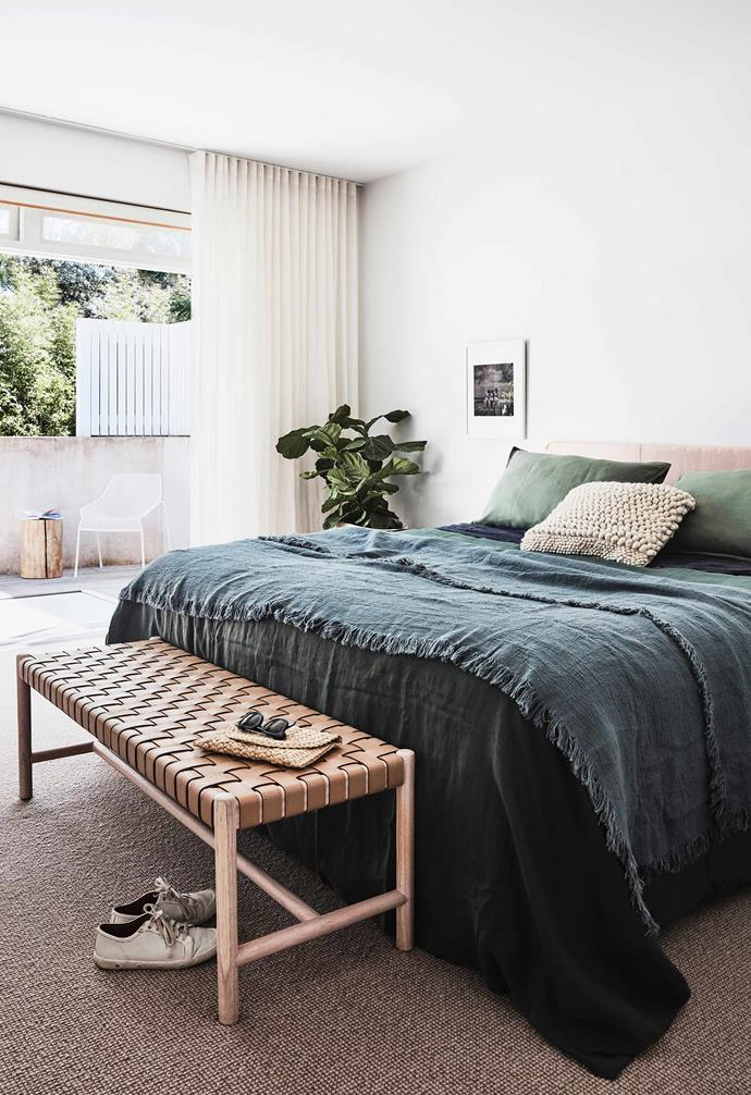 """**Bedroom** """"I like to put artwork where it feels right in the space, and that isn't always above the bed,"""" says Leah. To the side is a framed photograph bought on holiday in Paris. Flat leather bedhead, [Fenton & Fenton](https://www.fentonandfenton.com.au/ target=""""_blank"""" rel=""""nofollow""""). Linen, [In The Sac](https://inthesac.com.au/ target=""""_blank"""" rel=""""nofollow"""") and [In Bed](https://inbedstore.com/ target=""""_blank"""" rel=""""nofollow""""). Seed leather bench, [GlobeWest](https://www.globewest.com.au/ target=""""_blank"""" rel=""""nofollow""""). Chair and side table, [Eco Outdoor](https://www.ecooutdoor.com.au/ target=""""_blank"""" rel=""""nofollow"""")."""