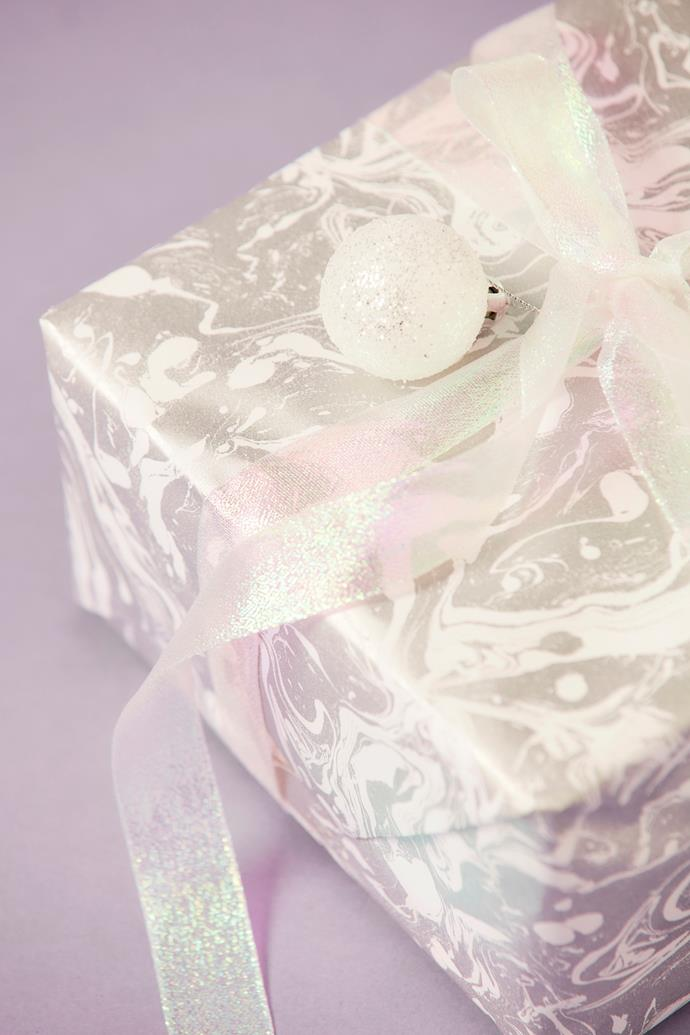 "Marble wrapping paper and iridescent ribbon, [Vandoros Fine Packaging](https://www.vandoros.com.au/|target=""_blank""