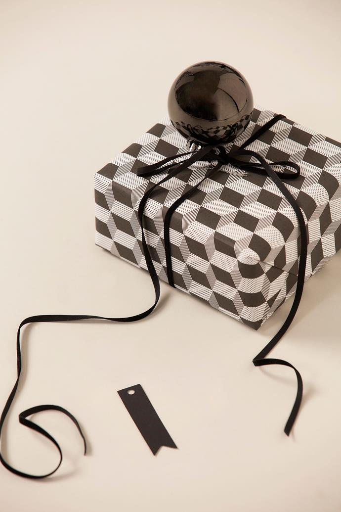 "Black ribbon and Black cube wrapping paper, [Vandoros Fine Packaging](https://www.vandoros.com.au/|target=""_blank""