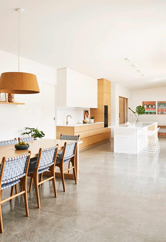 """**Kitchen/dining** """"We chose a polished concrete floor so the kids can zoom around on ride-on toys and it doesn't get  damaged,"""" says Georgia. Her butler's pantry hides a lot of mess. Carrara marble benchtops, with American oak-veneer cabinets. Table, [O Design by Brad Ottens](http://www.bradottens.com.au/