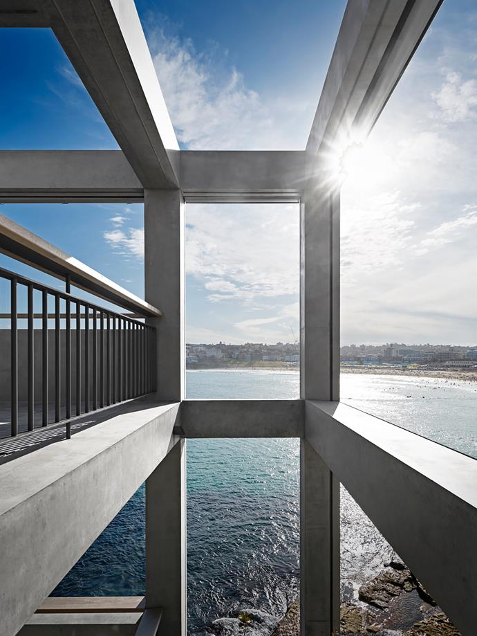 The house sits within an off-form concrete framework and affords close water views.  Custom-designed black steel balustrade with teak handrail.