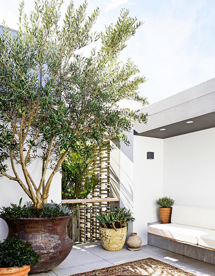 The top level courtyard is a contemporary interpretation of a traditional Moroccan roof terrace. Grigio San Marco floor tiles from Euro Marble. Erco wall lights.