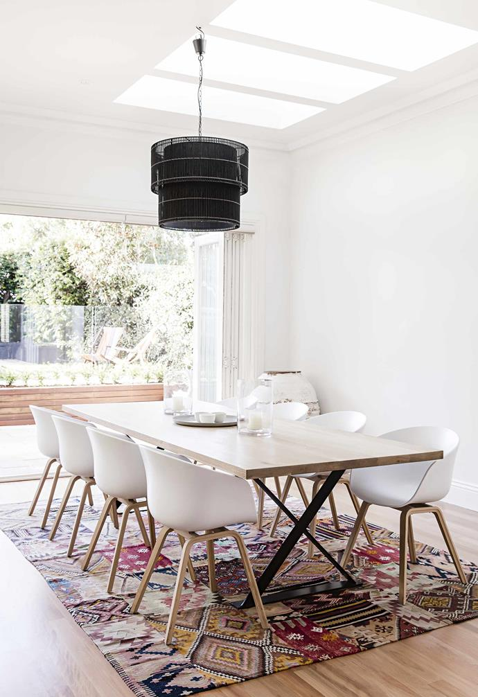 "**How did you come up with the design for the kitchen?**<br><br>My most important 'want' was to create an [efficient and functional layout](https://www.homestolove.com.au/popular-kitchen-layouts-and-designs-2336|target=""_blank"") for a family of five. We also wanted the largest island possible that was free from appliances. With those wishes in the back of our minds, the starting point for the kitchen's design was, as bizarre as it sounds, the laundry, which was originally located in a cupboard.<br><br>**Dining area** Curvy Hay chairs from [Pond](https://pond-pond.com/