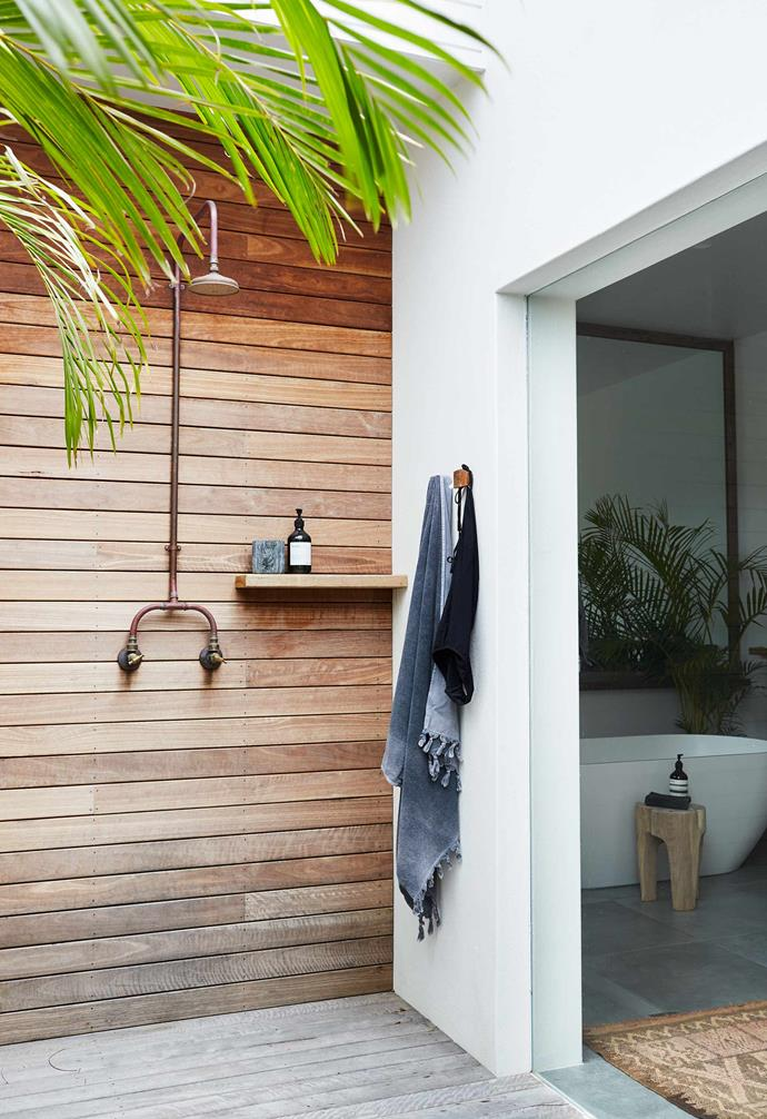 "The ensuite of this [Byron Bay, NSW, home](https://www.homestolove.com.au/relaxed-all-white-byron-bay-home-with-upcycled-details-19266|target=""_blank"") (designed by Dominic Finlay-Jones Architects) opens to a deck with an outdoor shower."