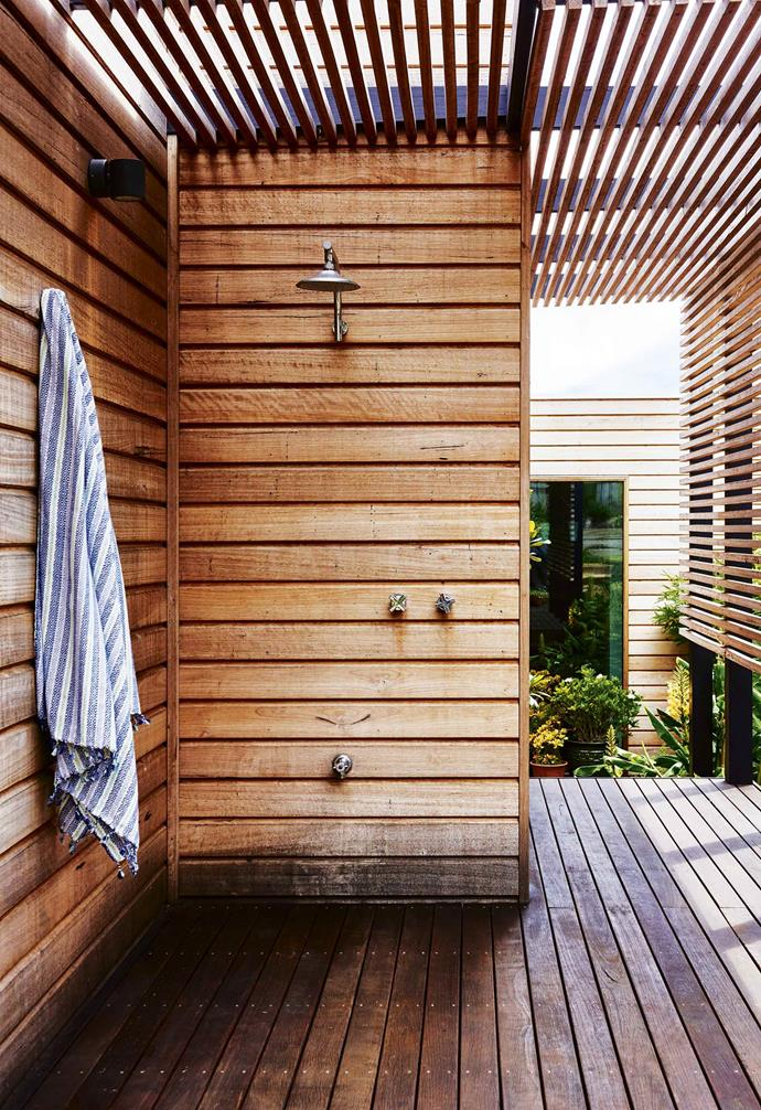 "In this [retro-style coastal home](https://www.homestolove.com.au/retro-coastal-home-torquay-18573|target=""_blank""), the outdoor shower was placed in the entryway corridor, where it is cleverly screened from view."