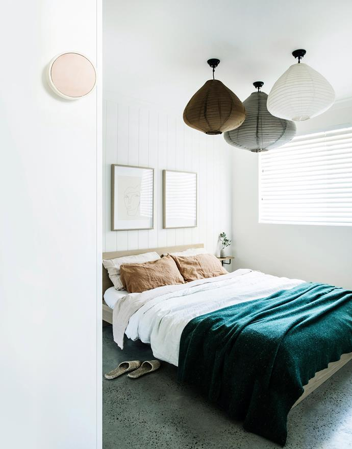 Don't scrimp on styling your guest bedroom. Beautiful bedlinen, artwork and statement lighting turn this simple room into a stylish space.