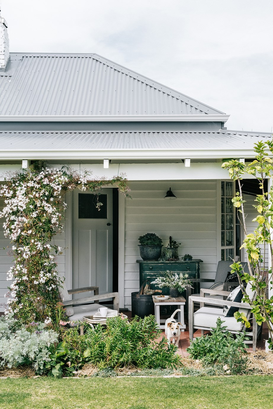 """We call these our gin and tonic chairs,"" says homeowner Fliss of this sunny spot on the verandah of her [coastal farmhouse](https://www.homestolove.com.au/coastal-farm-geographe-bay-20981