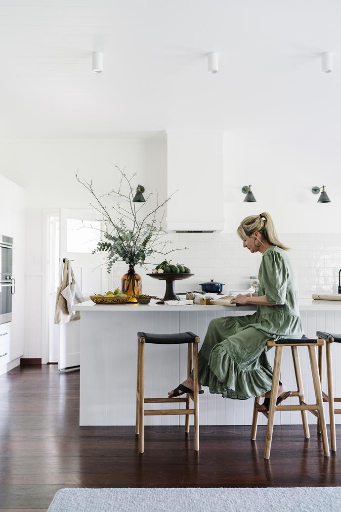 "Fliss chose an all-white scheme for her kitchen. ""I thought if I have a white base I can just add to it,"" she says. ""I love having big flower arrangements, bowls of fruit, layers of details and textures."" The display shown on the island bench combines Silver Dollar gum with pear tree branches."