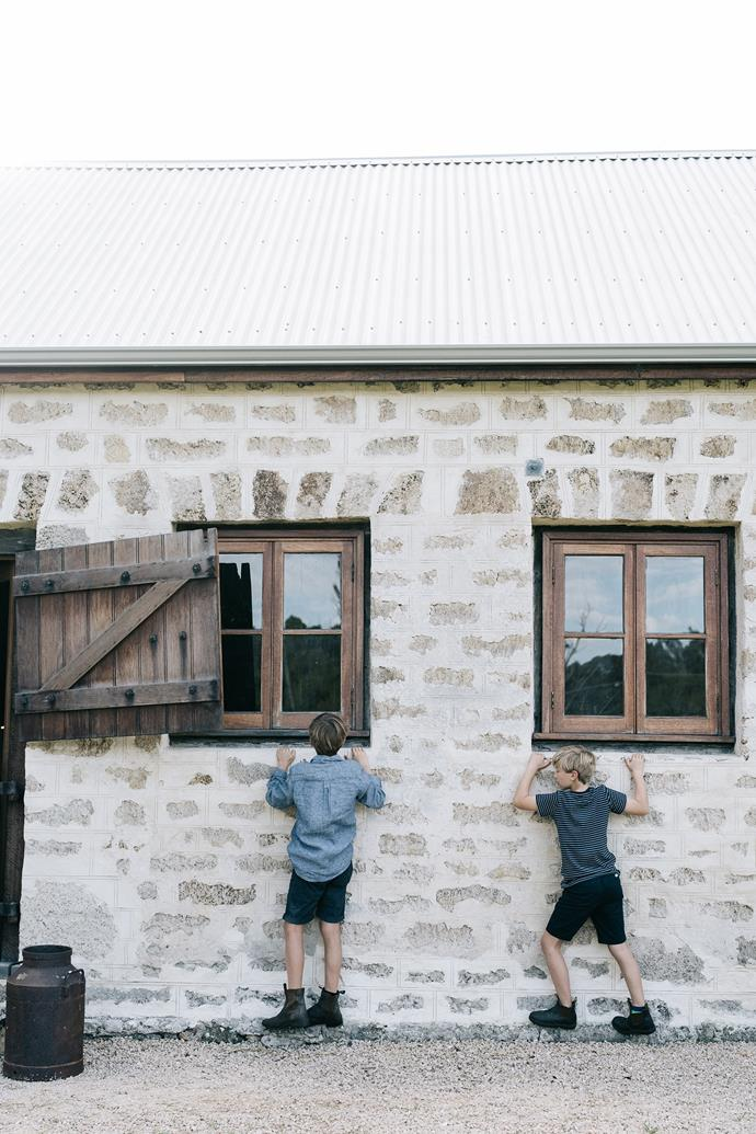 Jack and Fred edge their way along the stone footings of the stables. The limestone walls were restored by local stonemason Paul Young. The new windows are made from jarrah.