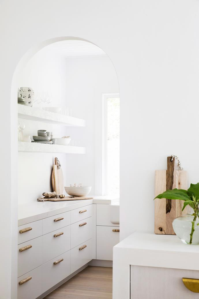 The butler's pantry offers an abundance of storage for the family.