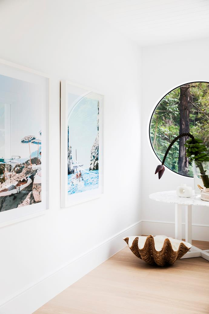 "For Sophie, entering what she describes as the ""art gallery foyer"" sets the tone for the rest of the house. Holiday snaps from her favourite getaways take pride of place and are available from her website."