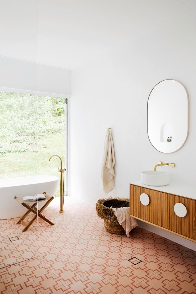 Brass tapware and warm-toned Bondi Encaustic tiles from Tile Cloud are a match made in heaven in this resort-style bathroom by Three Birds Renovations.