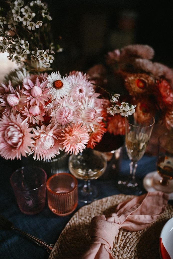 Vintage glassware perfectly complements the paper daisies.