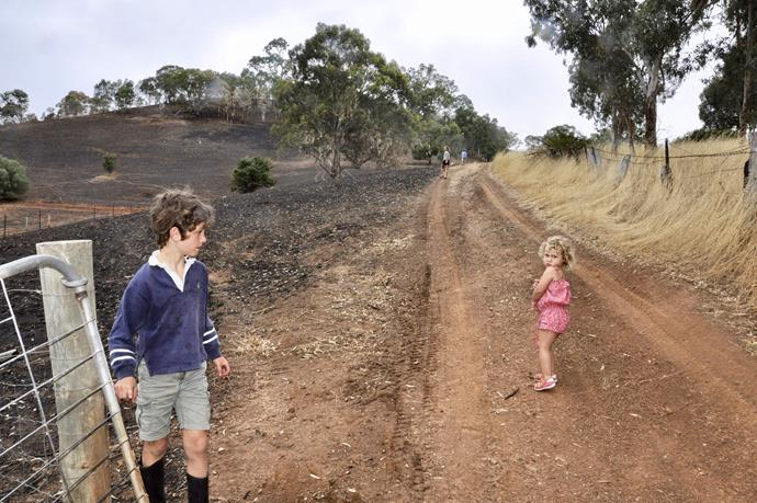 Sid and Meg at the gate after the bushfire.