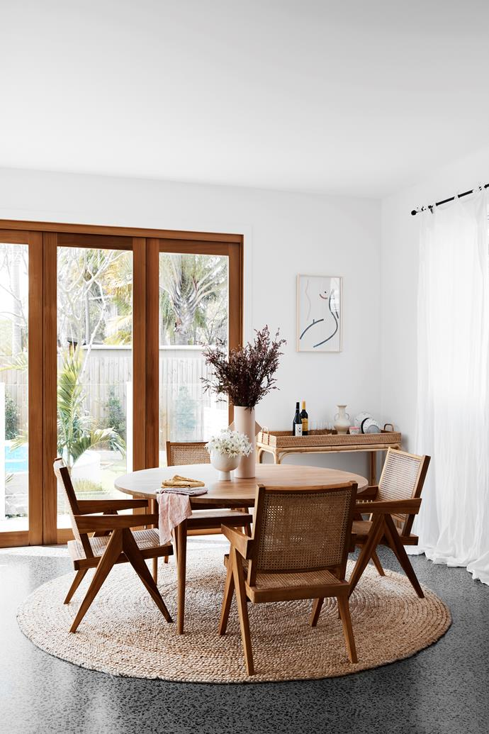 Meals are enjoyed around the table from Harpers Project, with the woven chairs and drinks trolley also Harpers Project pieces. The tall Blaze vase on the table is by Sarah Ellison.