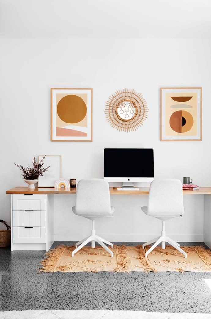 """I've never been one to use a separate office,"" Ellie says. ""I prefer to work from the main space of the home."" The chairs are Ikea, and a Justina Blakeney mirror and two Cacti Society prints by Nikki Joiner hang from the wall. A Langdon Ltd rug provides warmth underfoot."