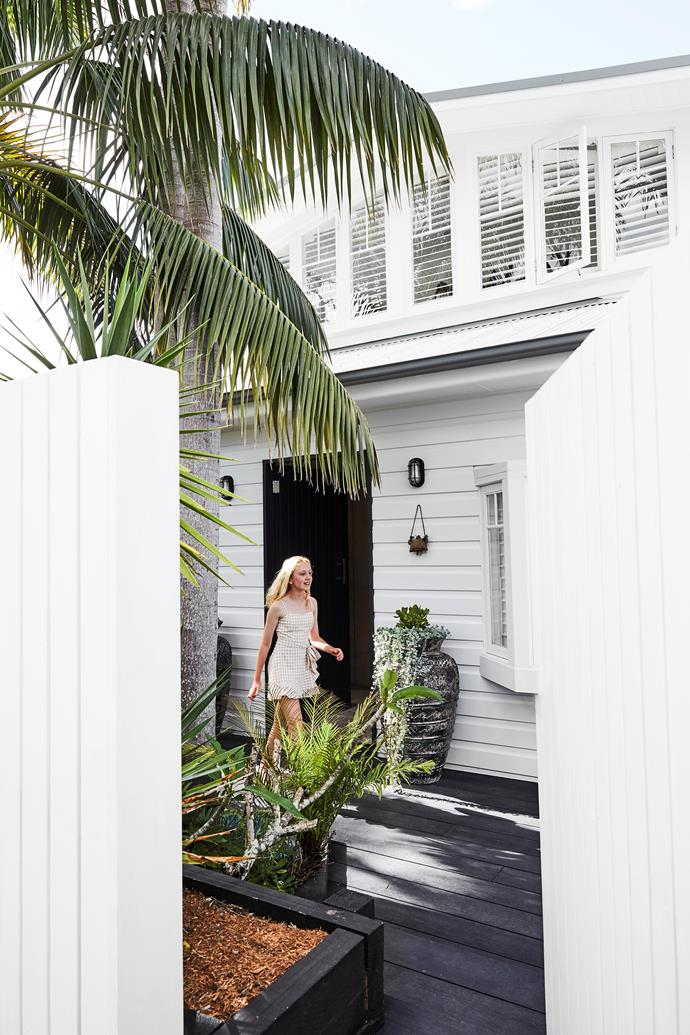 A breezy, beachy welcome awaits visitors to this Sydney home. Daughter Lola steps out of the front door.