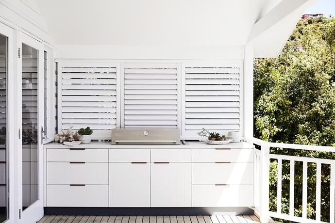 A Beefeater barbecue is set into the Caesarstone Calacatta Nuvo bench. Louvres by signature shutters and joiner y by Mandziy 's Just Joinery.