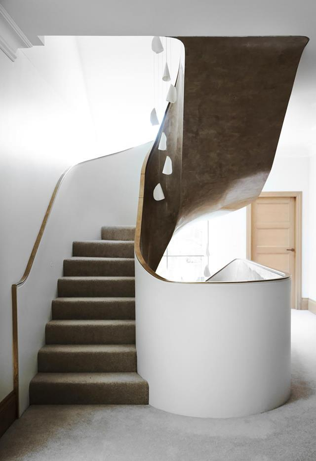 """The original elegant arches within this [heritage home](https://www.homestolove.com.au/heritage-property-fashioned-into-elegant-house-20094