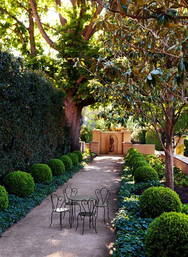 "Clipped box spheres emphasise the balance and formality of this [classic garden](https://www.homestolove.com.au/verdant-formal-garden-by-paul-bangay-20619|target=""_blank"")."
