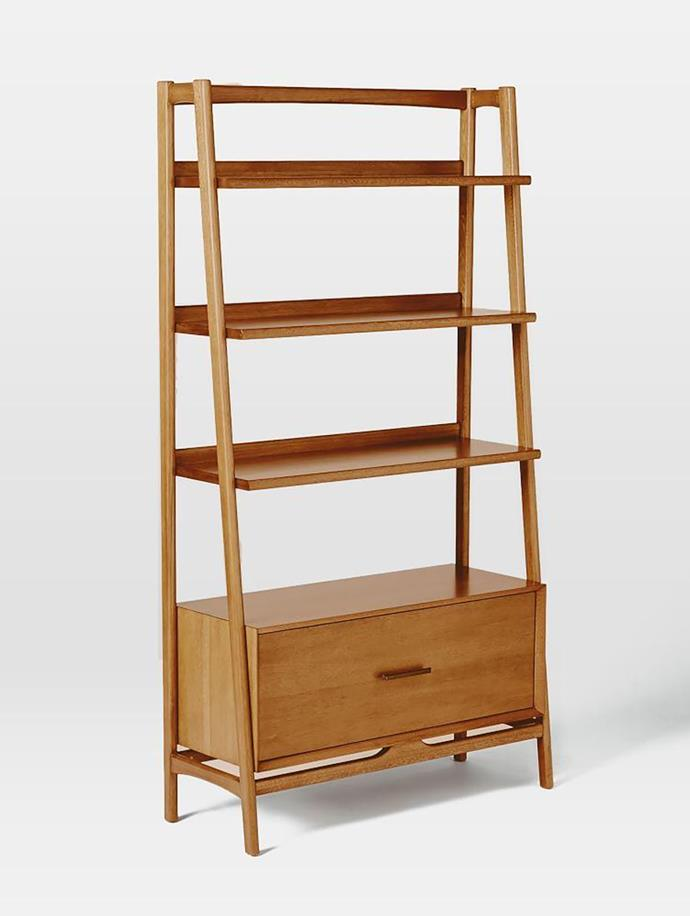 """This mid century-style bookshelf borrows its slim legs and bevelled edges from iconic '50s and '60s furniture silhouette. It features three shelves and a practical storage unit to hide mess. <br>  Mid-Century bookshelf in acorn, $999, available at [West Elm](http://www.westelm.com.au/mid-century-bookshelf-wide-h1056/