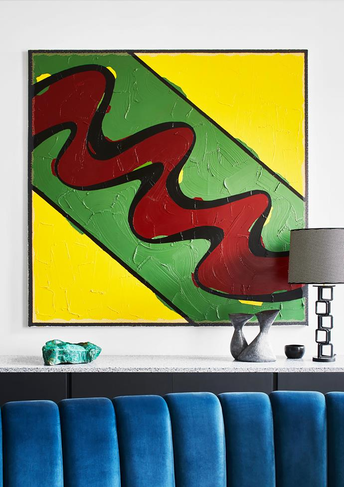 An artwork by Bertrand Lavier delivers a smack of colour to the mostly monochromatic interiors.