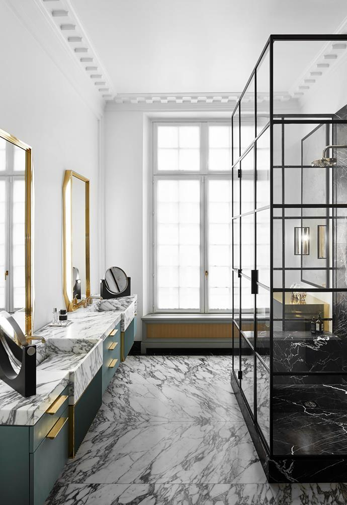 Mirrors with brass trim by Humbert & Poyet reflect a dazzling scene in the bathroom with generous slabs of Arabescato marble and timber drawers finished in hand-brushed lacquer.