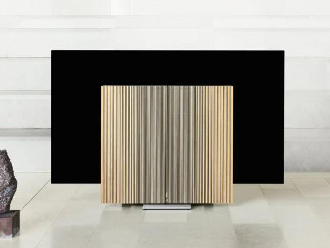 "**[Bang & Olufsen BeoVision Harmony, $33,000](https://www.bang-olufsen.com/en/televisions/beovision-harmony?utm_medium=cjaffiliate&utm_source=Skimlinks&cjevent=c20b1d1938b411ea83df00340a1c0e12|target=""_blank"")**. No, Bang & Olufsen don't make TVs, but they did partner with LG to create this sculptural piece. Essentially B&O created the rotating panel speakers - made from oak and aluminium - which turn out like butterfly wings when the TV is in use and fold back when not, semi-hiding the unsightly black screen. The TV itself is an 77"" LG C9 OLED screen which retails alone for $12,299 and is by all account, top-notch. So if you have the budget and you're looking for a showstopping piece, add this to your list.  **Best for:** The high-end, minimalist home.      ***See it in action in the video below***"