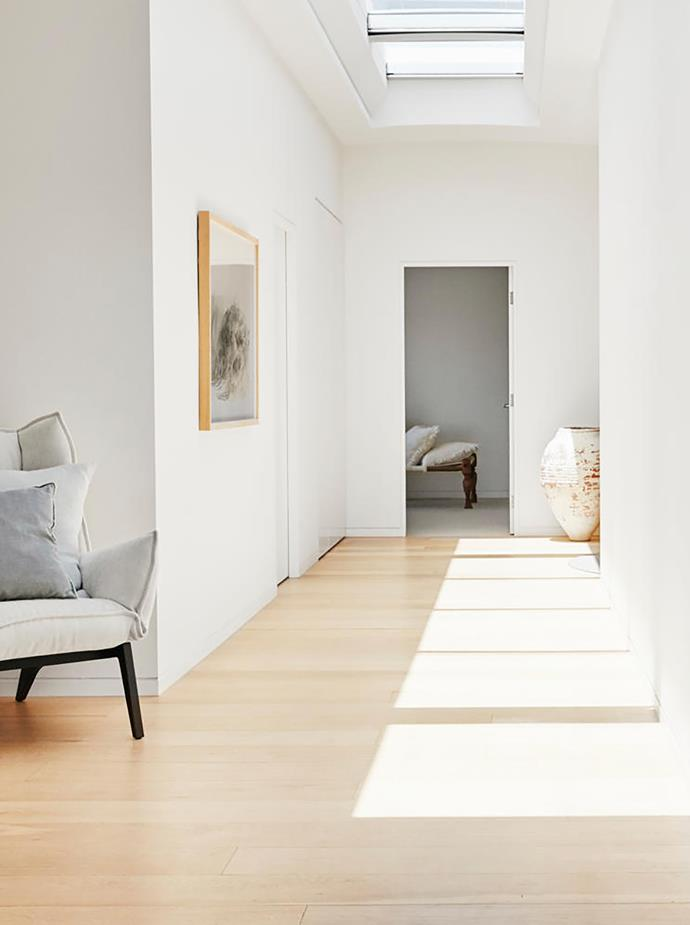 In the light-filled hallway, Ligne Roset 'Toa' armchair from Domo, White Tiger artwork by Eugene Tan from Aquabumps, daybed from Orient House and Turkish pot from Water Tiger.