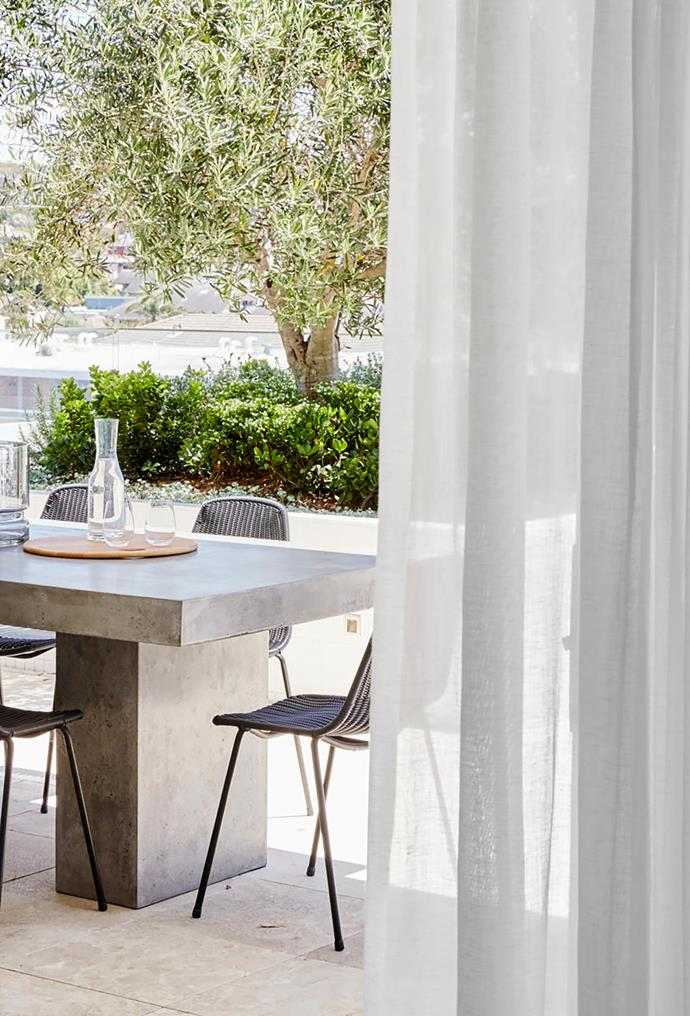 'Raphael' concrete outdoor dining table from Papaya matched with chairs from Stylecraft.