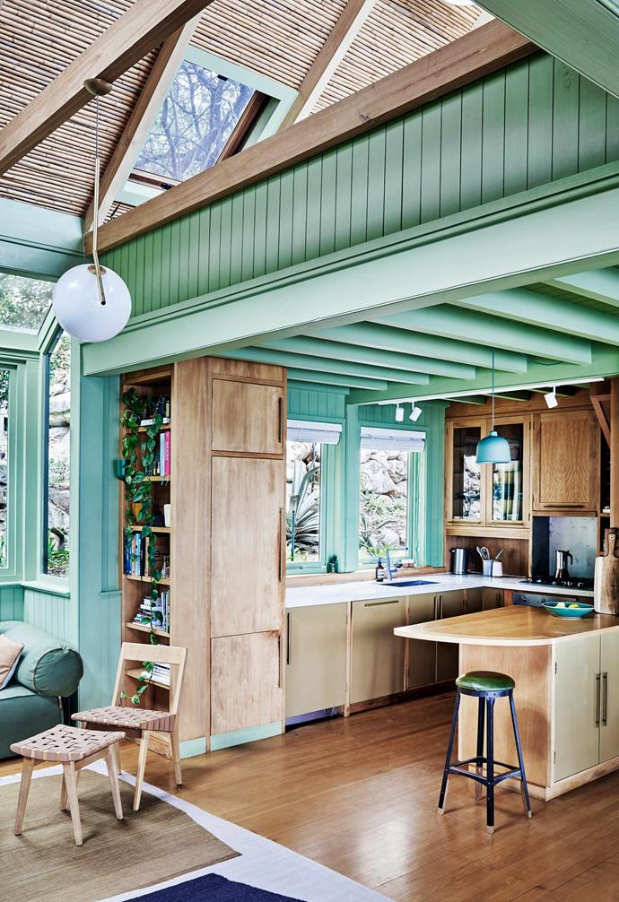 "**Kitchen** Painting the entire house green — including some ceilings — was one of the few major changes made to the original home. Stool by [Gregor Jenkin](https://www.gregorjenkin.com/|target=""_blank""