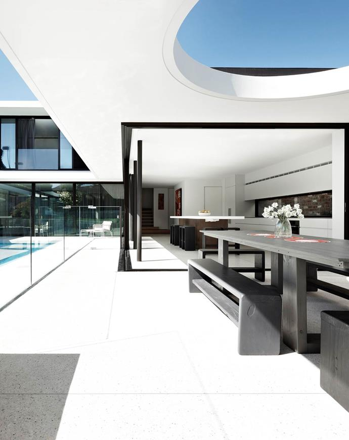 The retractable roof over the alfresco area of this mckimm-designed home is a standout feature with its circular cut-out echoing other geometric shapes throughout the project.