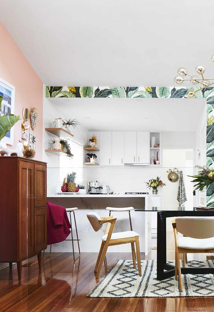 "**Dining area and kitchen** An open-plan layout leads to a compact but functional kitchen. To the left of the dining table, above a vintage teak cocktail cabinet, is a print of Slim Aarons' 1960s photo El Vanero from [YellowKorner](https://www.yellowkorner.com/|target=""_blank""