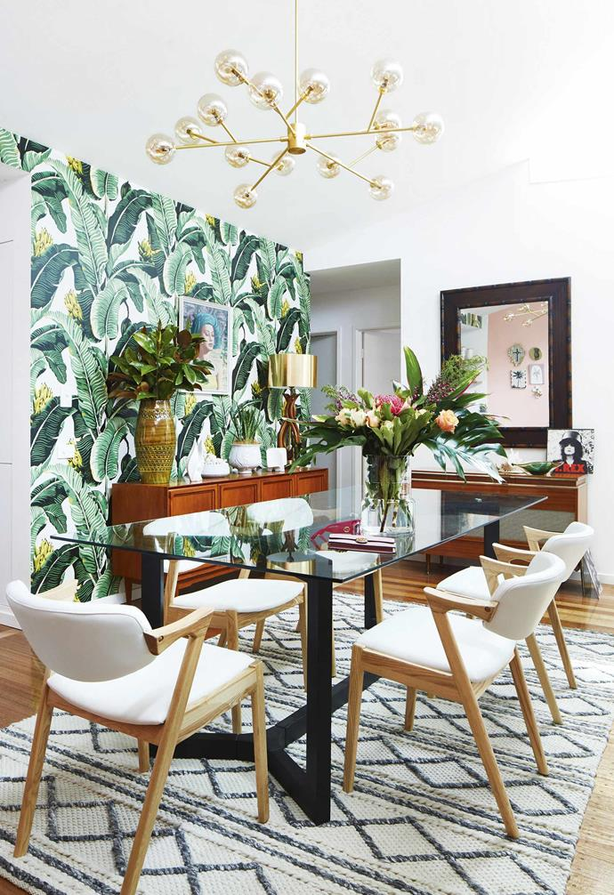 """**Dining area** Glass-topped furniture is seen throughout the living areas. The slim profile of the table enhances the sense of space – Vanessa bought it 10 years ago, when she purchased the home. """"It fits the space so well that I have hung on to it,"""" she says."""
